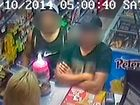 The two men with the pink jar of charity money that they allegedly stole.