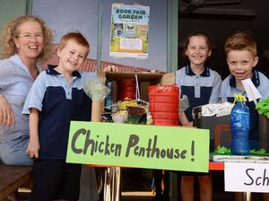 SUSTAINABILITY: St Joseph's Primary School teacher Nikki Wagner with (from left) Cohen Ducan, Layla Davidson and Heath Tyler. In front is the Chicken Penthouse and a school model, created with the help of SCU mentors.