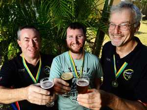 HERE'S CHEERS: Ipswich Brewers Union members Tony Brown, Michael Johnson and Roger Lawrance toast their success at the recent national championships in Canberra.