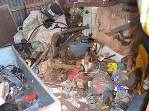 The outdoor shed filled with junk at the McIlwraith St, Childers, property. Photo taken October 28, 2014. Photo Matthew McInerney / NewsMail