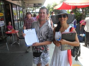 Bella Trevillian(l) gets some help gathering signatures to bring triple j's One Night Stand to the Clarence Valley. Photo: Marco Magasic / Daily Examiner