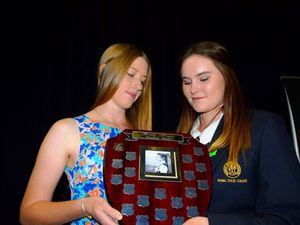 REMEMBERING HER: Roma State College senior Imogen Newton holds the Emily Payne Memorial Award with Emily's twin sister Abby. Photo Tom Gillespie / The Western Star