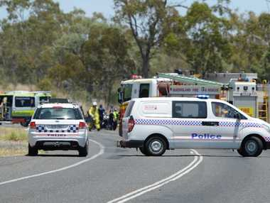 Police and other emergency services attend a crash between a motorcyc