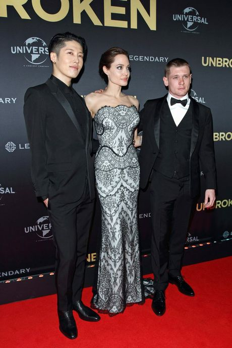 Director Angelina Jolie with the stars of her movie Unbroken, Takamasa Ishihara, left, and Jack O'Connell in Sydney. Supplied by Universal Pictures.