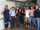 A FRIENDLY rivalry between two Toowoomba businesses has spawned a team effort in support for The Chronicle's violence awareness campaign.
