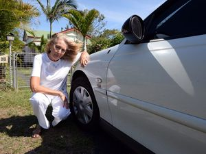 ROTTEN ACT: Cynthia Hoogstraten had a bottle thrown at her car as she was driving across the Burnett Traffic Bridge. The bottle smashed on the road and punctured one of her tyres. She is asking to have CCTV surveillance installed on the bridge. Photo: Max Fleet / NewsMail