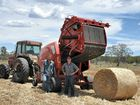 WELL CUT: James Forsyth and Shane Christian baling straw on Jason Larsen's property.