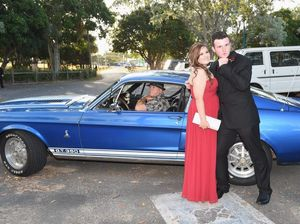 Hervey Bay State High School students Ashley Whiteside and Tim Scott arrive in style for their formal at the Waterfront Restaurant in Urangan.
