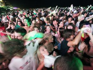 Thousands of young people party during one of the organised events during the Schoolies festival on Queensland's Gold Coast, Saturday, Nov. 21, 2009. Police, emergency services, security guards and officials will maintain a highly visible presence during the Gold Coast Schoolies week, providing the community and visitors with additional support and assistance. (AAP Image/Dean Saffron) NO ARCHIVING