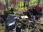 A 24-year-old man has been trapped in a vehicle overnight that rolled off the Mount Morgan Range.