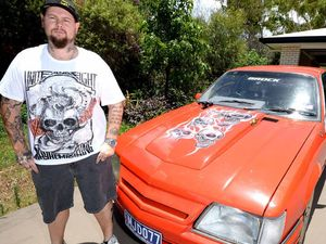 IN A SPIN: Matt Doyle with his Commodore that has been pulled over by police.