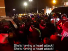 FOOTAGE has emerged of police seemingly firing tear gas and rubber bullets into a crowd of protesters carrying an apparently unconscious woman in Ferguson.