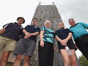 Chaplain Mark Macrae, school captain Stephen Brunkie, MP Anne Maddern, school captain Kayla Kissack and principal Dale Hansen at Carinity Education Glendyne's climbing wall.