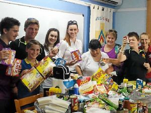 GOOD WORK: Tropical North Leos president Harrison Comelli, Blaze Grant, Joel Cashmen, Tayla Comelli, Taylah Shaw, Eileen Young, Leanne Comelli, Alycia Carroll and Helen Carroll with their food donation.