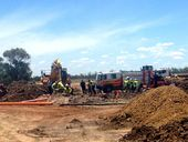 EMERGENCY services are currently working to rescue a man trapped in a trench on Pilot Farm Rd.