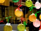 Brightly coloured hand crafted glass Christmas decoration at the Old Bus Depot Markets