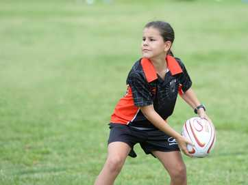 Action from the Queensland Bulls touch football coaching clinic held in Rockhampton on Saturday.