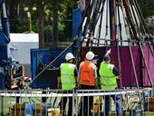 A MAN has been crushed to death while dismantling an amusement ride at a Christmas Carols event held in an Ipswich school.