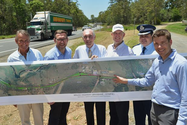 Deputy Prime Minister, Warren Truss announces the up-grade of Bruce Highway intersection at Gold Nugget Service Station, Gympie. At front right, Scott Whitaker - District Director of Transport for Main Roads with Wide Bay, Burnett region showing the highway up-grade plan to from left Garth Madill representing the Madill Motor Group, owners of the The Nugget Service Station and Truck Stop with Member for Gympie, David Gibson MP, Deputy Prime Minister Mr Warren Truss, Gympie Regional Council Acting Mayor Tony Perrett and Police Inspector Jon Lewis. Photo: Greg Miller / Gympie Times