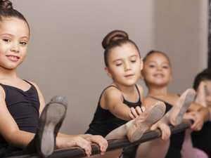 SHOW TIME: Preparing for a ballet show takes a lot of time, effort and hair spray for parents.
