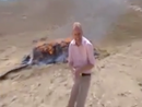 BBC reporter loses it near pile of burning drugs