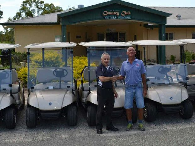 Tin Can Bay Australia  city photo : HELPING HAND: Tin Can Bay Golf Club member Greg Tritton right with ...