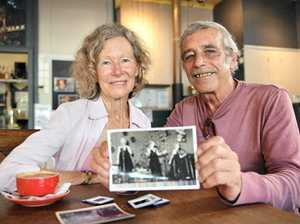 CHANCE MEETING: Sharyn Chapman, who was a performer on a concert tour to Vietnam, and Paul Stockwell, who served as an Army Private in Vietnam, looking over old photos.
