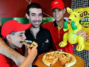 AUSSIE AS: Pizza Hut's Ashleigh Pole, Cheyne Gordon and Jack Hamilton are proud of the new Mitey stuffed crust.