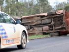 Driver trapped after car rolls