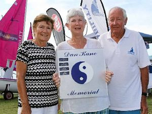 PAYING TRIBUTE: Whitsunday Sailing Club Yachtsperson of the year Heather Sutton (centre), was presented with the Dan Kane Memorial Trophy by Dan's parents Mim and John Kane (left and right) at the club on Australia Day.