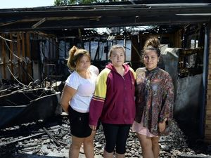 HEARTBREAK: Crystal, Sophia Ale and Dolores in front of the rental property that was destroyed in Goodna overnight.