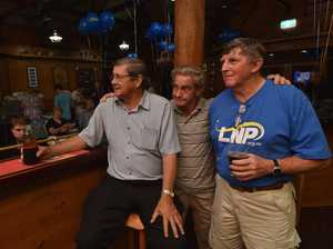 Hervey Bay LNP candidate Ted Sorensen with supporters Ian Dinte and Gary Lawlor, keep an eye on the television as results start coming in early in the evening.