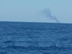 A boat fire, as seen from near Five Mile Reef.