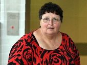 A GOLD Coast woman who allegedly defrauded a Maryborough business out of $93,000 to fund a luxury cruise has had her matter mentioned in court.