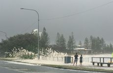 Wild weather is creating sea foam on the Sunshine Coast attracting locals who are taking photos and videos.