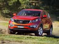 Grant Edwards drives the updated version of his personal car, the MY14 Kia Sportage SLi.