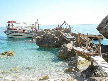Take The Love Boat cruise around the island of Karpathos for a rustic experience. TOP RIGHT: Discover a forgotten world at Olympos where bent women keep tradition.