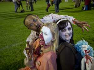 Showing their best zombie impersonation are (from left) David Moore, Mimi Banks and Sonya Moore at Toowoomba's Zombie Walk to raise funds for the Toowoomba Hospital Foundation , Saturday, February 28, 2015. Photo Kevin Farmer / The Chronicle