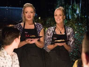 """Sheri and Emilie serve their entree during their second """"redemption"""" instant restaurant in Toowoomba."""