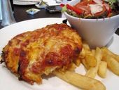 AN IRATE deep-fried poultry lover is crying foul over The Chronicle's decision to ban his photograph of a chicken parmigiana from a Facebook competition.