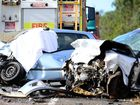 A HONG Kong tourist who killed two Hervey Bay men in a high-speed crash after allegedly crossing over to the wrong side of the road will remain behind bars until her trial.