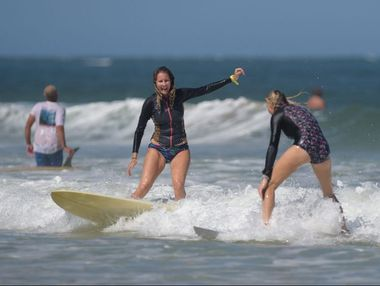 The endless summer just keeps on keeping on for surfers Melissa Meekan, left, and Kathryn Scorsone who were enjoying some waves at Happy Valley, Caloundra. Photo: Brett Wortman / Sunshine Coast Daily