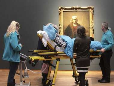 A 78-year-old woman was able to enjoy a hugely popular exhibition of Rembrandt paintings in a private viewing.