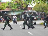 THOUSANDS of specially trained Australian sleeper-agents in Bali this morning began a snap invasion of Indonesia.