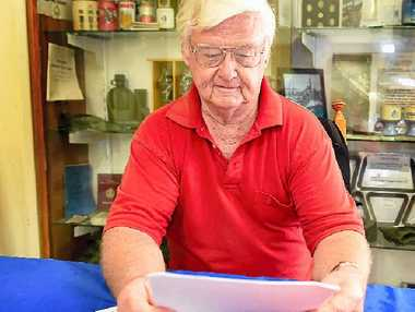 LEFT, IT'S A BATTLE: Vietnam veteran Jock Young looks over the pension increase paperwork.