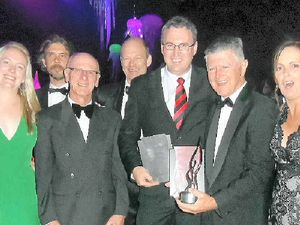 HONOURED: Coolum Surf Club general manager Mal Wright and director John Ellingsen, centre, celebrate the Clubs Queensland awards with fellow members.