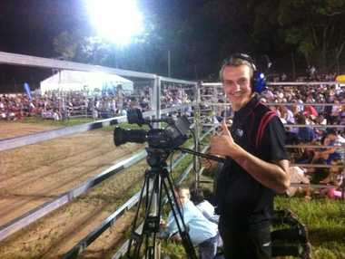 Alex Finney loving his job as the cameraman atg the PBR Photo Marco Magasic / Daily Examiner