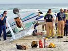 Emergency services with a light plane that flipped while making a forced landing on Tomahawk Beach yesterday.