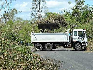 CYCLONE CLEAN-UP: Work is still under way in Marcia's aftermath.