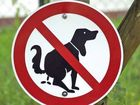 UNDER a new law designed to tackle Britain's dog poo problem, owners caught without a poop scooping bag will be fined £100 or AUD$190